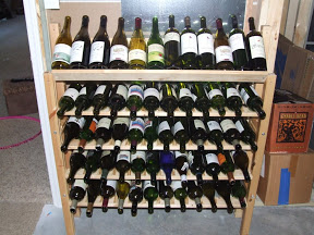 wine rack fully loaded with 60 bottles